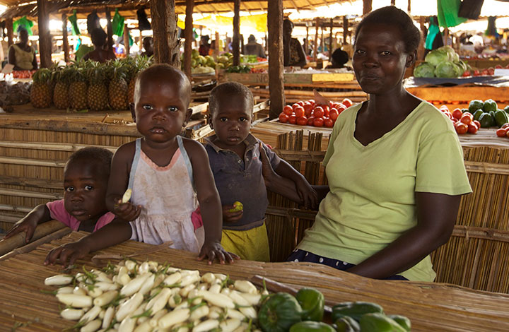 WGEF client with her children at the market